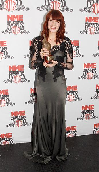 Bringing a bit of gothic charm to the NME Awards red carpet, the Brit chose this gunmetal satin dress with lace sleeves to perform in (and, hey, while she's there she might as well pick up a few award