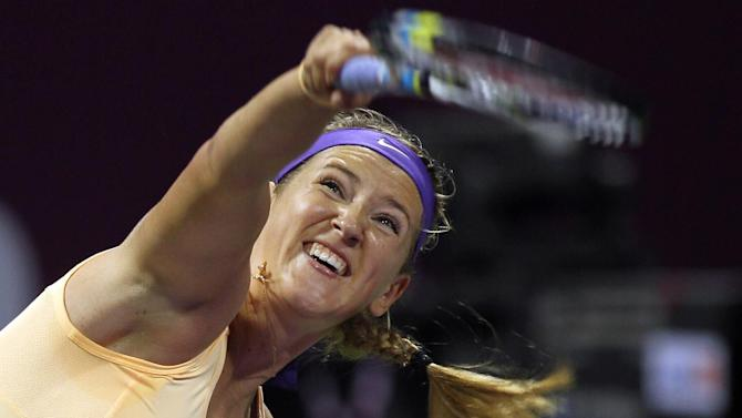 Belarus Victoria Azarenka returns the ball during her match against Romina Oprandi of Switzerland on the Third day of the WTA Qatar Ladies Open in Doha, Qatar, Wednesday, Feb. 13, 2013. (AP Photo/Osama Faisal)