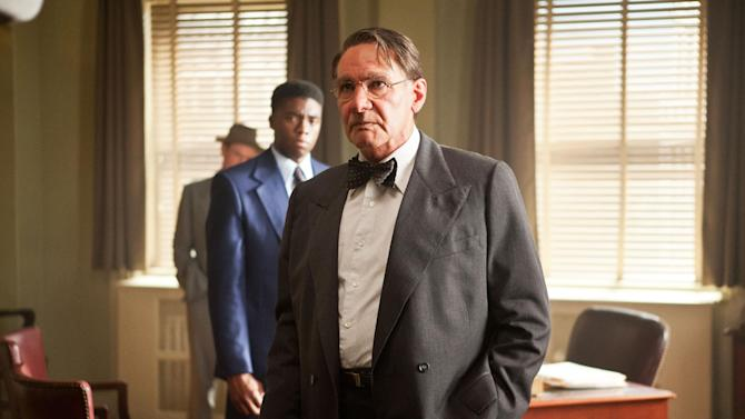 """This publicity film image released by Warner Bros. Pictures shows Chadwick Boseman, left, as Jackie Robinson and Harrison Ford as Branch Rickey in Warner Bros. Pictures' and Legendary Pictures' drama """"42,"""" a Warner Bros. Pictures release. (AP Photo/Warner Bros. Pictures, D. Stevens)"""