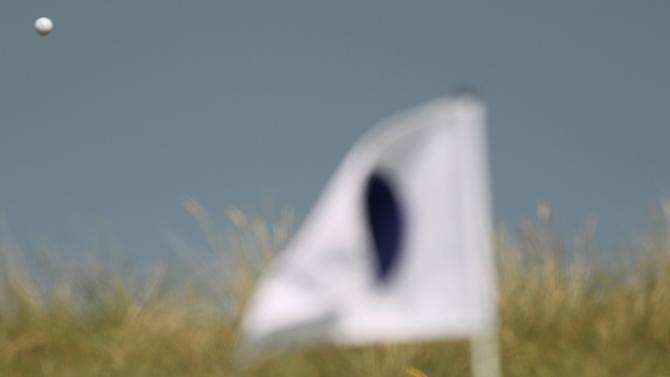 Rickie Fowler of the US hits a shot during a practice round ahead of the British Open Golf Championship at Royal St George's golf course in Sandwich, England, Monday, July 11, 2011. (AP Photo/Tim Hales)