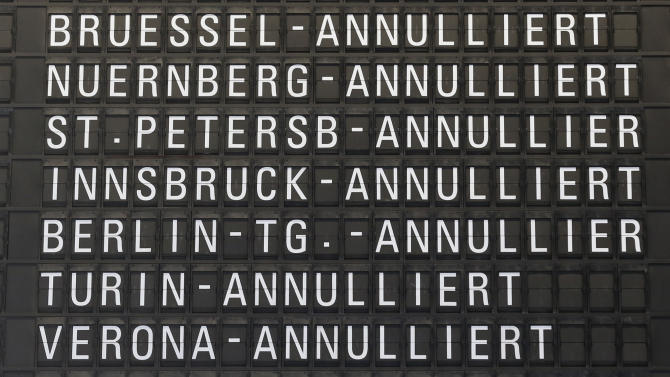 Cancelled flights appear on a board as public-sector employees of the Frankfurt airport went on a warning strike, demanding higher wages in Frankfurt, Germany, Thursday, March 27, 2014. Germany's largest airline Lufthansa alone said it was cancelling 600 flights Thursday, from primarily within Europe, as a result of the strike. (AP Photo/Michael Probst)