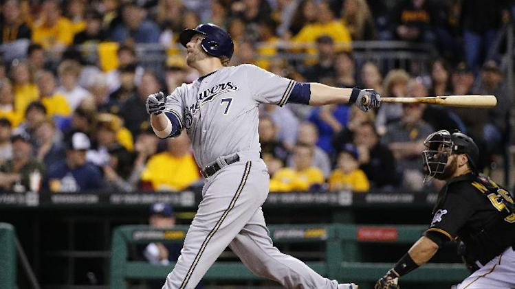 Milwaukee Brewers' Mark Reynolds (7) bats during a baseball game against the Pittsburgh Pirates in Pittsburgh Friday, April 18, 2014. The Brewers won 5-3. (AP Photo/Gene J. Puskar)