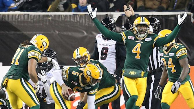 Edmonton Eskimos' Bowman celebrates after Lynch scored what proved to be the winning touchdown against the Ottawa Redblacks during the CFL's 103rd Grey Cup championship football game in Winnipeg