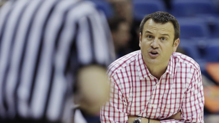 Louisville head coach Jeff Walz argues a call with an official in the second half against California during a national semifinal at the Women's Final Four of the NCAA college basketball tournament, Sunday, April 7, 2013, in New Orleans. (AP Photo/Dave Martin)