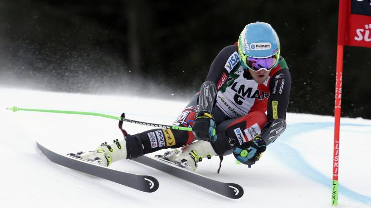 Ligety of the U.S. clears a gate during the first run in the men's World Cup giant slalom skiing race in Alta Badia