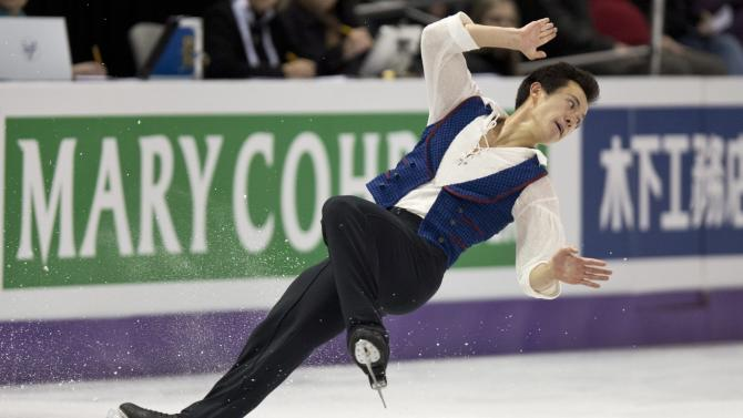Canada's Patrick Chan falls during his free skate program in the men's competition at the World Figure Skating Championships Friday, March 15, 2013 in London, Ontario. (AP Photo/The Canadian Press, Paul Chiasson)