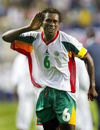Senegal name ex-captain Cisse as coach