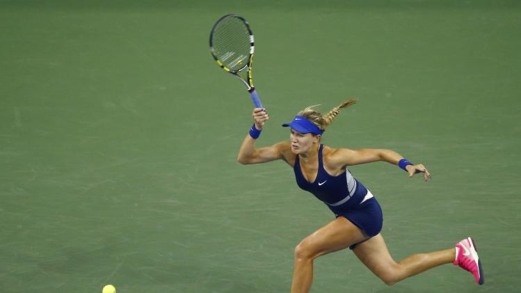 Eugenie Bouchard of Canada returns a shot to Barbora Zahlavova Strycova of the Czech Republic during their women's singles match at the U.S. Open tennis tournament in New York
