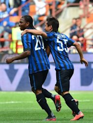 Inter Milan's Joel Obi (L) celebrates after scoring with Inter Milan's Japanese midfielder Yuto Nagatomo during their Serie A football match between Inter Milan and Cesena at San Siro Stadium in Milan on April 29