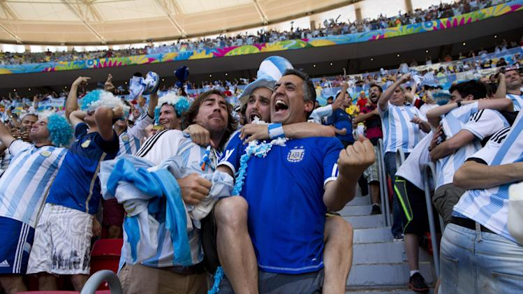 Argentina soccer fans celebrate their team's World Cup quarterfinal victory over Belgium at the Estadio Nacional, in Brasilia, Brazil Saturday, July 5, 2014. Gonzalo Higuain's first goal of this World Cup sent Argentina into the semifinals on Saturday with a 1-0 win over Belgium