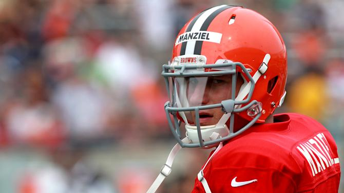 Cleveland Browns quarterback Johnny Manziel looks over the field during the NFL football team's training camp that was held at InfoCision Stadium in Akron, Ohio, Saturday, Aug. 2, 2014. (AP Photo/Aaron Josefczyk)