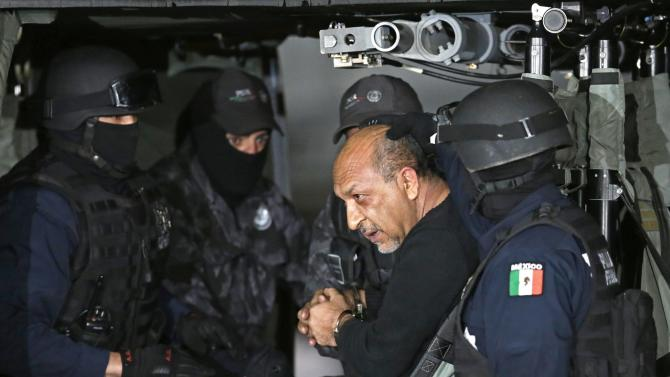 "Servando ""La Tuta"" Gomez boards a helicopter during a media conference about his arrest in Mexico City"