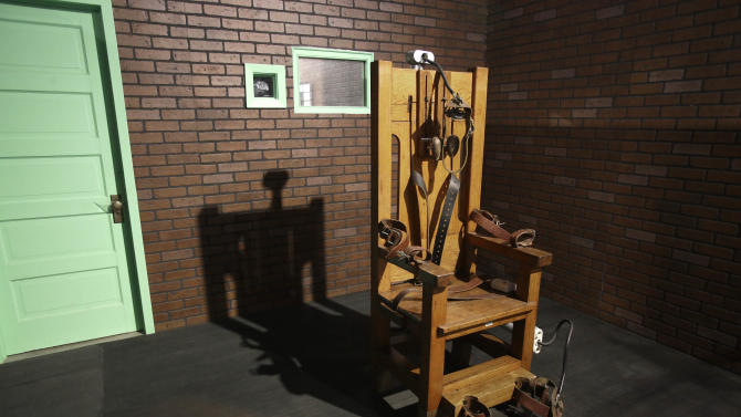 This photo taken May 16, 2013, shows an electric chair on exhibit at the Texas Prison Museum in Huntsville, Texas. Between 1924 and 1964, 361 men died in the electric chair. Since the first execution by lethal injection in Texas in 1982 the state has executed 499 prisoners. (AP Photo/Pat Sullivan)