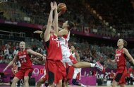 USA's Diana Taurasi drives to the basket against Canada's Courtnay Pilypaitis during a women's basketball game at the 2012 Summer Olympics, Tuesday, Aug. 7, 2012, in London. (AP Photo/Charles Krupa)
