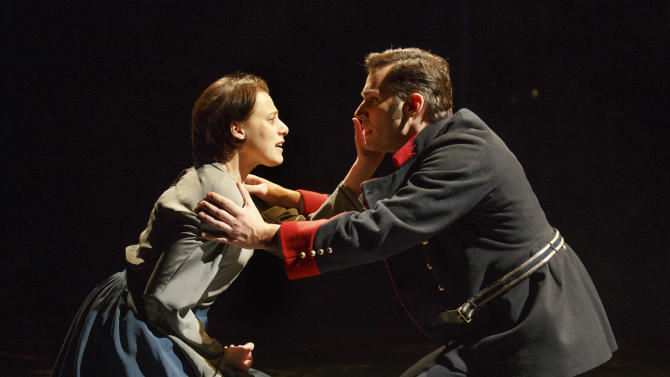 """This undated image released by The Publicity Office shows Judy Kuhn, left, and Ryan Silverman in a scene from the Stephen Sondheim-James Lapine musical, """"Passion,""""  performing off-Broadway at Classic Stage Company in New York. (AP Photo/The Publicity Office, Joan Marcus)"""