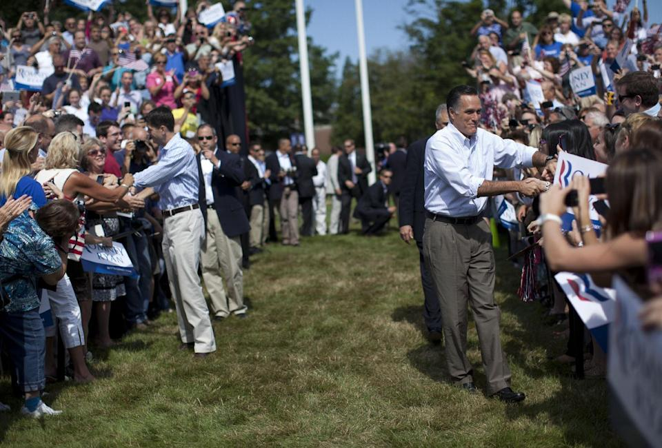 Republican presidential candidate, former Massachusetts Gov. Mitt Romney, right, and vice presidential running mate Rep. Paul Ryan, R-Wis., left, shake hands as they arrive to a campaign rally, Monday, Aug. 20, 2012 ,in Manchester N.H.  (AP Photo/Evan Vucci)