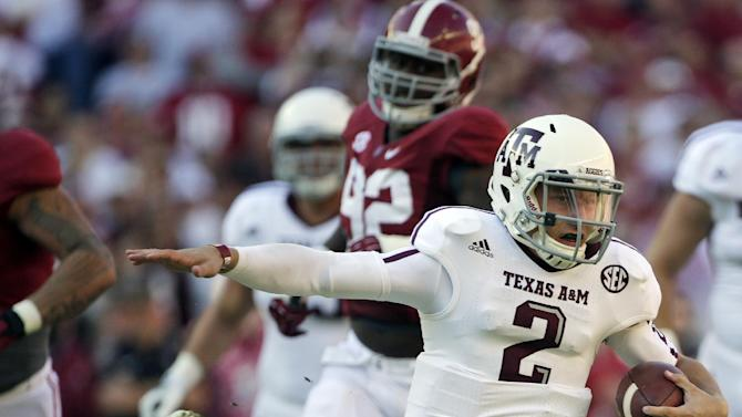 FILE - In this Nov. 10, 2012, file photo, Texas A&M quarterback Johnny Manziel (2) looks for running room during the first half of an NCAA college football game against Alabama at Bryant-Denny Stadium in Tuscaloosa, Ala. Manziel could become the first freshman to win the Heisman Trophy when the award is presented on Saturday night. (AP Photo/Dave Martin, File)