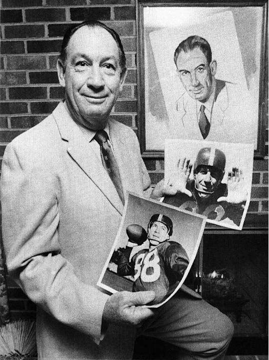 "In this Feb. 8, 1972 file photo, Clearance ""Ace"" Parker displays pictures of his playing days after receiving news he had been elected to the Pro Football Hall of Fame, in Portsmouth, Va. Parker, the"