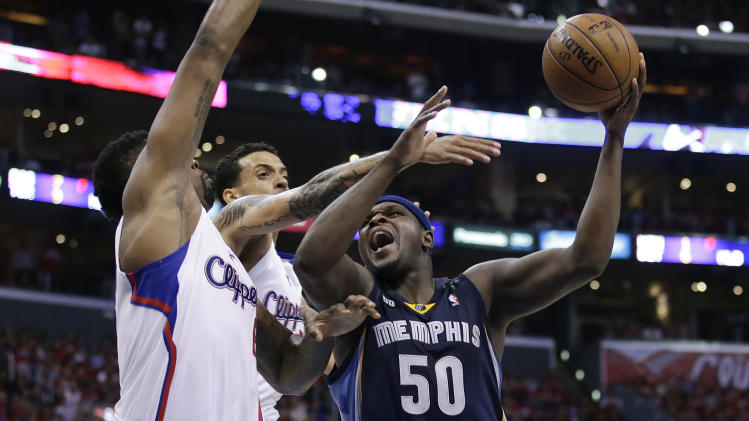 Memphis Grizzlies' Zach Randolph, right, shoots as he is defended by Los Angeles Clippers' DeAndre Jordan, left, and Matt Barnes during the second half in Game 5 of a first-round NBA basketball playoff series in Los Angeles, Tuesday, April 30, 2013. The Grizzlies won 103-93. (AP Photo/Jae C. Hong)