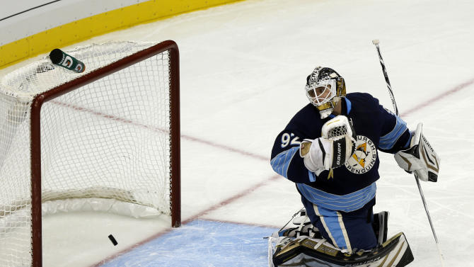 Pittsburgh Penguins goalie Tomas Vokoun (92) looks to the net where New Jersey Devils' David Clarkson scored a goal in the first period of an NHL hockey game on Sunday, Feb. 10, 2013, in Pittsburgh. (AP Photo/Keith Srakocic)