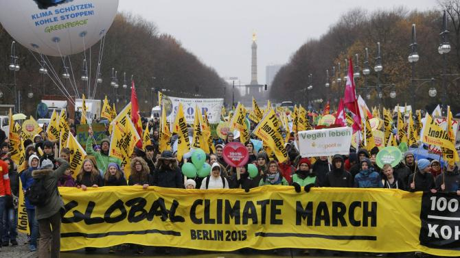 People demonstrate during a protest march in Berlin ahead of COP21 summit