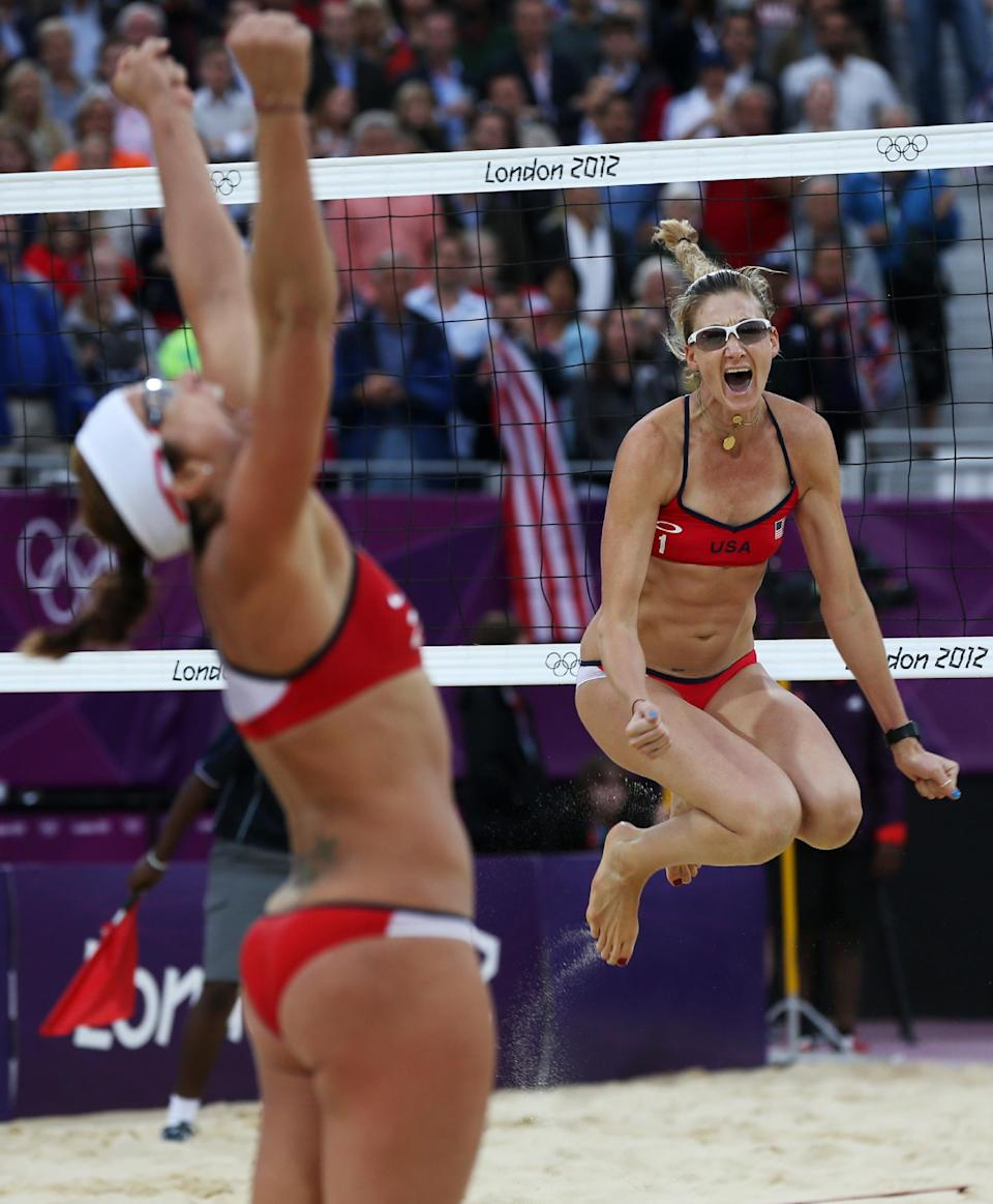 United States' Misty May-Treanor, left, and Kerri Walsh Jennings celebrate after defeating China in their semifinal women's beach volleyball match at the 2012 Summer Olympics, Tuesday, Aug. 7, 2012, in London. (AP Photo/Petr David Josek)