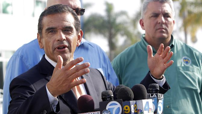 Los Angeles Mayor Antonio Villaraigosa talks during a news conference on the port strike negotiations at the Port of Los Angeles on Tuesday, Dec. 4, 2012.  Villaraigosa says both sides in a strike at the twin ports of Los Angeles and Long Beach have agreed to federal mediation. The union representing clerical workers says the strike now in its eighth day will continue in the meantime. (AP Photo/Nick Ut)