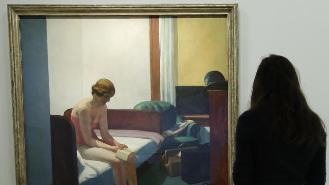 """A woman looks at """"Hotel Room, 1931"""" as part of the retrospective of Edward Hopper, one of the great American 20th century artists at Paris' Grand Palais Museum, in Paris, Monday, Oct. 8, 2012.  This major Hopper retrospective reveals that the 20th century painter known for his rendering of American life, also drew inspiration from France, and includes some 128 Hopper works, such as the masterpieces """"Nighthawks"""" and """"Soir Bleu"""". (AP Photo / Francois Mori)"""