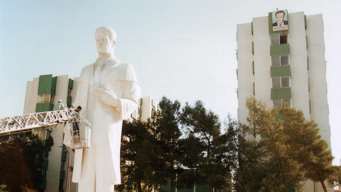 """In this undated photo taken between 1997 and 1998 and made available Monday, Sept. 19, 2011, workers install a statue of Syria's former president Hafez al-Assad at the University of Damascus students residency city, in Damascus, Syria. It was built to commemorate al-Assad's re-nomination as leader of Syria's Baath Party and a new presidential term, which will take place in a celebration called as """"Renew the pledge of allegiance.""""(AP Photo/Mohammad Hannon)"""