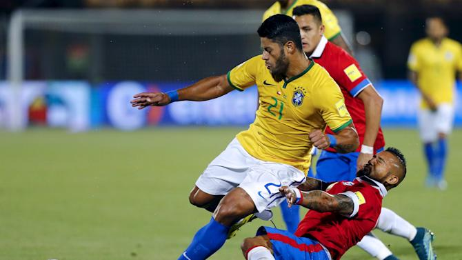 Hulk of Brazil fights for the ball with Vidal of Chile during their 2018 World Cup qualifying soccer match in Santiago