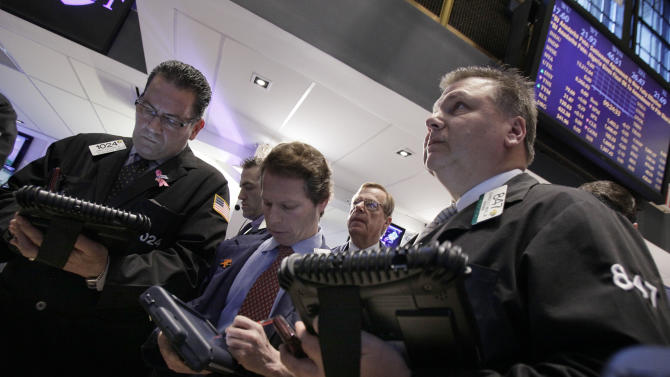 In an April 2, 2012 photo traders work on the floor of the New York Stock Exchange.  Wall Street was headed to a lower opening Thursday April 5, 2012, with Dow Jones futures down 0.2 percent and S&P 500 futures losing 0.2 percent  (AP Photo/Richard Drew)