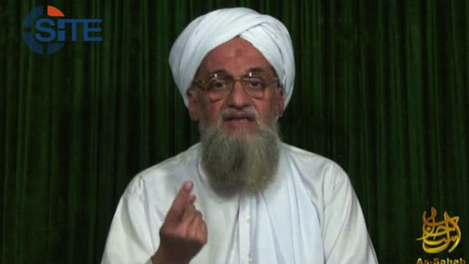 """FILE - This frame grabbed file image from video provided by the SITE Intel Group, Sunday, Feb. 12, 2012, an American private terrorist threat analysis company, purports to show al-Qaida's leader Ayman al-Zawahri in a still image from a web posting by al-Qaida's media arm, as-Sahab, calling on Muslims across the Arab world and beyond to support rebels in Syria who are seeking to overthrow President Bashar Assad. Iraq's top diplomat on Thursday, July 5, 2012 said he had """"solid information"""" that al-Qaida militants were crossing from Iraq to Syria to carry out attacks, warning of a violent spillover that could shake the Middle East.(AP Photo/SITE Intel Group, File)  THE ASSOCIATED PRESS HAS NO WAY OF INDEPENDENTLY VERIFYING THE CONTENT, LOCATION OR DATE OF THIS PICTURE. MANDATORY CREDIT: SITE Intel Group"""