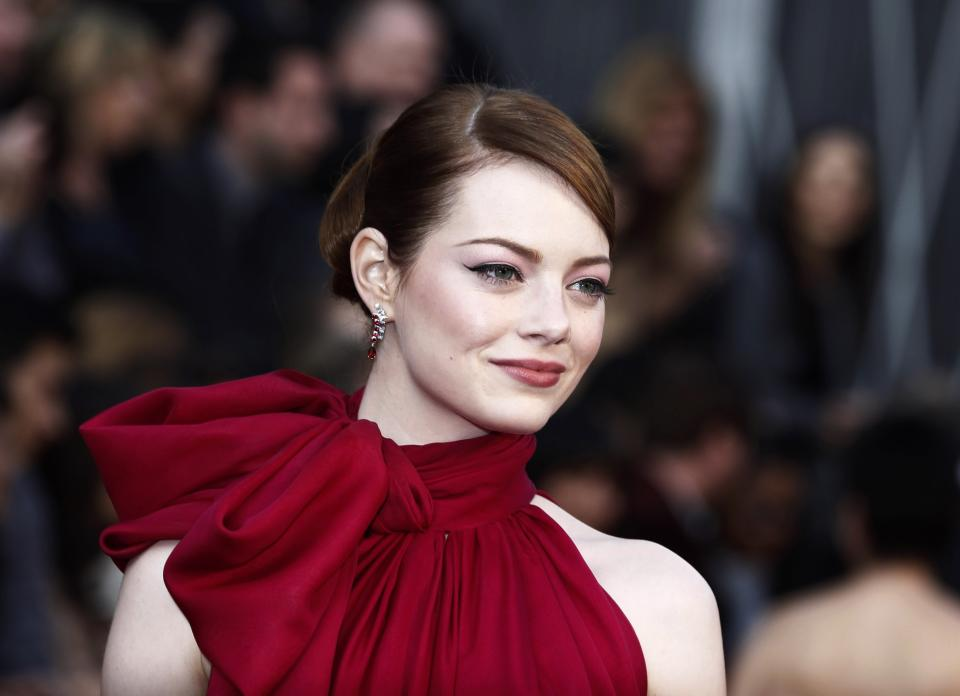 FILE - In this Feb. 26, 2012 file photo, actress Emma Stone arrives before the 84th Academy Awards, in the Hollywood section of Los Angeles. (AP Photo/Matt Sayles, File)