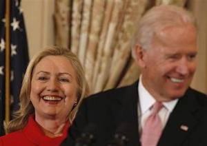 U.S. Secretary Clinton listens to Vice President Biden at State Department in Washington