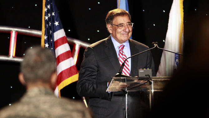 Secretary of Defense Leon Panetta is applauded before speaking about suicide prevention at the annual Suicide Prevention Conference held by the Dept. of Defense and Veterans Administration, in Washington, on Friday, June 22, 2012. (AP Photo/Jacquelyn Martin)