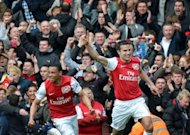 Arsenal's Robin van Persie (R) celebrates after scoring during their English Premier League match against Norwich City at The Emirates Stadium in London, on May 5. Manager Arsene Wenger takes his team to West Brom on Sunday knowing a victory will secure third place