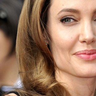 Angelina Jolie opened up about her double mastectomy battle at the World War Z premiere last night [Rex]