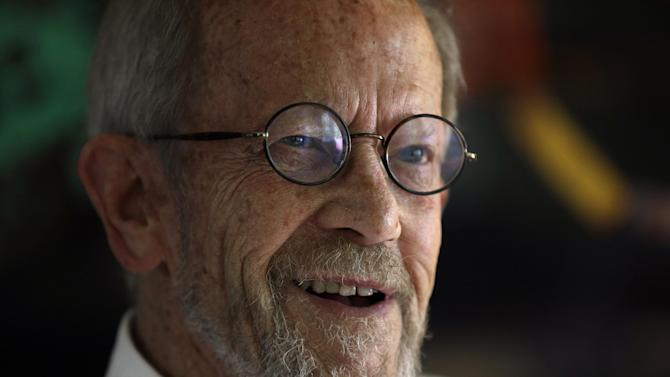 FILE - In this Monday, Sept. 17, 2012 file photo, Author Elmore Leonard, 86, smiles during an interview at his home in Bloomfield Township, Mich. Leonard, a former adman who later in life became one of America's foremost crime writers, has died. He was 87. His researcher says he passed away Tuesday morning, Aug. 20, 2013 from complications from a stroke. (AP Photo/Paul Sancya)