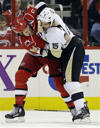 Penguins clinch Atlantic by beating 'Canes 5-3