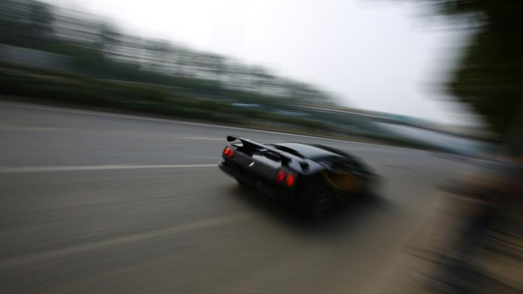 Wang drives a handmade replica of Lamborghini Diablo on a street during a test drive in Beijing