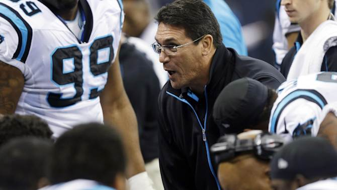 Carolina Panthers head coach Ron Rivera talks to some players during the first half of an NFL football game against the New Orleans Saints Sunday, Dec. 30, 2012, in New Orleans. (AP Photo/Bill Haber)