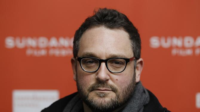 """FILE - In this Jan. 22, 2012 file photo, Director Colin Trevorrow poses at the premiere of """"Safety Not Guaranteed"""" during the 2012 Sundance Film Festival in Park City, Utah. Trevorrow is taking the reins of """"Jurassic Park."""" The 36-year-old director will helm """"Jurassic Park 4,"""" Universal Pictures and Amblin Entertainment announced Thursday, March 14, 2013. (AP Photo/Danny Moloshok, File)"""