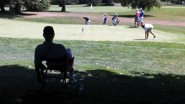 Phil Jones sits in the shade, with a view of the 11th green as the temperature rose into the 90s, during the pro-am of the LPGA Tour's Safeway Classic golf tournament at Pumpkin Ridge Golf Club in North Plains, Ore. (AP Photo/The Oregonian, Michael Lloyd) MAGS OUT, TV OUT, LOCAL TV AND INTERNET OUT, (THE MERCURY, WILLAMETTE WEEK, PAMPLIN MEDIA GROUP OUT)