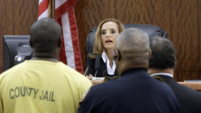 Shannon Miles, left, stands before Judge Denise Collins, center, during a hearing in state District Court Monday, Aug. 31, 2015, in Houston. Miles has been charged with capital murder in the death of Harris County Sheriff's Deputy Darren Goforth. He is being held without bond. (AP Photo/Pat Sullivan)