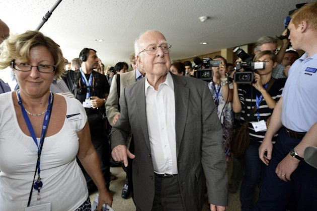 British physicist Peter Higgs arrives for a press conference about the latest update in the search for the Higgs boson at the European Organization for Nuclear Research (CERN) in Meyrin near Geneva, Switzerland, Wednesday, July 4, 2012. The head of the world's biggest atom smasher is claiming discovery of a new particle that he says is consistent with the long-sought Higgs boson known popularly as the &quot;God particle&quot; which is believed to give all matter in the universe size and shape. (AP Photo/Keystone/Martial Trezzini)