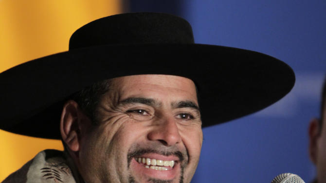"FILE - In this March 24, 2011 file photo, Mario Sepulveda, a Chilean miner that was trapped underground for more than two months, smiles during a news conference in South Orange, N.J.. Spanish actor Antonio Banderas will star as Sepulveda in the film ""The 33"" who dramatizes the cave-in at a mine in Chile's Atacama desert and the globally televised rescue of the miners that mesmerized millions worldwide. (AP Photo/Seth Wenig, File)"