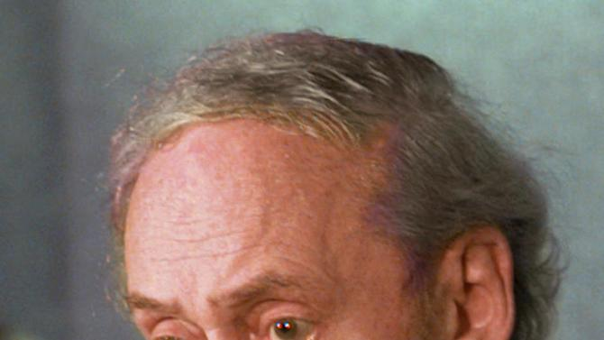 FILE - In this May 18, 1998 file photo, Robert Bork, a lobbyist for Netscape, meets reporters at the National Press Club in Washington to discuss the suit filed by the Justice Department and 20 state governments against Microsoft charging the software giant with using unfair tactics to crush competition and restrict choice for consumers.    Robert H. Bork, who stepped in to fire the Watergate prosecutor at Richard Nixon's behest and whose failed 1980s nomination to the Supreme Court helped draw the modern boundaries of cultural fights over abortion, civil rights and other issues, has died. He was 85.  (AP Photo/Susan Walsh