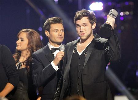 "Phillips holds trophy after being named winner during the 11th season finale of ""American Idol"" in Los Angeles"