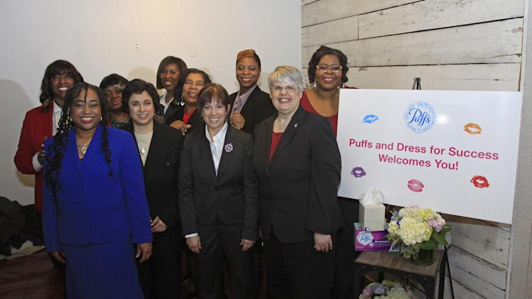 "IMAGE DISTRIBUTED FOR PUFFS - Dress for Success women pose after receiving makeovers during the Puffs Tissues 'Kisses"" event on Tuesday, Feb. 12, 2013 at High Five Salon in Cincinnati, Ohio, home of Proctor & Gamble. (Skip Peterson/AP Images for Puffs)"