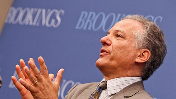 This handout photo provided by the Brookings Institution, taken Tuesday, June 25, 2013, shows Health and Human Services Director of the Center for Consumer Information and Insurance Oversight Gary Cohen speaking at the Institution in Washington. _ Nearly 2 in 3 uninsured low-income people who would qualify for subsidized coverage under President Barack Obama's health care law may be out of luck next year because their states have not expanded Medicaid. An Associated Press analysis of figures from the Urban Institute finds a huge coverage gap developing, with 9.7 million out of 15 million potentially eligible low-income adults living in states that are refusing the expansion or still are undecided with time running short. (AP Photo/Brookings Institution, Paul Morigi)